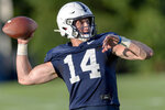 Penn State quarterback Sean Clifford throws during NCAA college football practice, Wednesday, Aug. 28, 2019 in State College, Pa. (Joe Hermitt/The Patriot-News via AP)