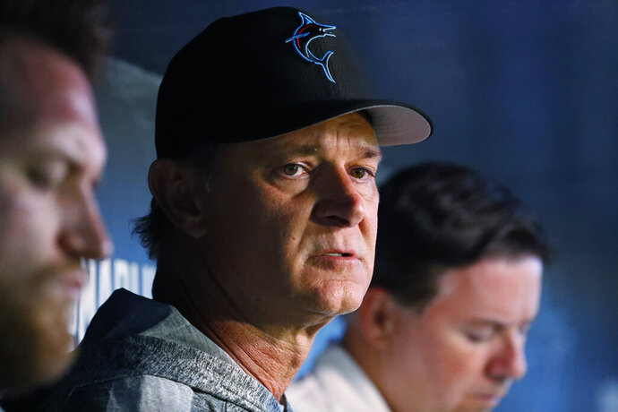 FILE - In this July 16, 2019, file photo, Miami Marlins manager Don Mattingly speaks to members of the media before the start of a baseball game against the San Diego Padres, in Miami. The Dolphins look like the worst team in the NFL, and might even be the worst team in Miami. On the other hand, a comparison with the Marlins is one matchup the Dolphins might win. (AP Photo/Wilfredo Lee, File)