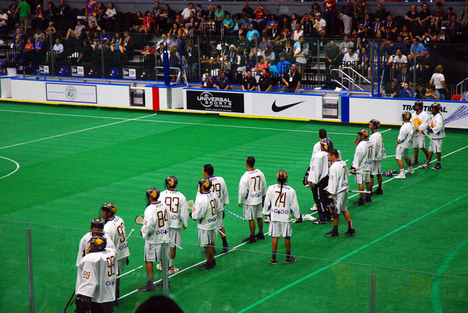 This Sept. 18, 2015 photo shows the Iroquois Nationals lacrosse team line up prior to competing in the 2015 World Indoor Lacrosse Championships on the Onondaga Nation just south of Syracuse, New York. The Ireland Lacrosse team recently bowed out of the sport's top international tournament to open up a spot for the Iroquois Nationals. It's the latest in a series of gestures between the country and U.S. tribes that date back to 1847, when Choctaw leaders gave $170 to the Irish as their country battled a potato famine that resulted in the death of tens of thousands. Historians estimate today's value of the amount at roughly $5,000. (Jourdan Bennett-Begaye/Indian Country Today via AP)