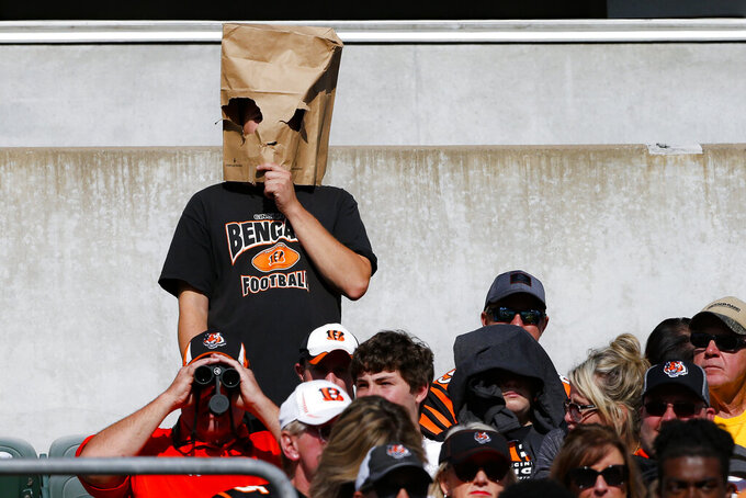 A fan reacts in the second half of an NFL football game between the Cincinnati Bengals and the Jacksonville Jaguars, Sunday, Oct. 20, 2019, in Cincinnati. (AP Photo/Gary Landers)