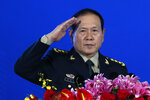 Chinese Defense Minister Wei Fenghe salutes after delivering his opening speech for the Xiangshan Forum, a gathering of the region's security officials, in Beijing, Monday, Oct. 21, 2019. Wei is issuing a stinging rebuke of the U.S. at a defense forum in Beijing, saying China wasn't fazed by sanctions, pressure and a