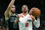 Houston Rockets' Russell Westbrook, right, shoots against Boston Celtics' Jayson Tatum during the first half of an NBA basketball game in Boston, Saturday, Feb. 29, 2020. (AP Photo/Michael Dwyer)