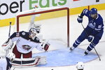 Columbus Blue Jackets goaltender Joonas Korpisalo (70) makes a save as Toronto Maple Leafs center John Tavares (91) looks for a rebound during the third period of an NHL Eastern Conference Stanley Cup playoff game in Toronto on Sunday, Aug. 9, 2020. (Nathan Denette/The Canadian Press via AP)