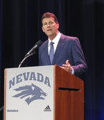 """New Nevada men's basketball coach Steve Alford answers a question at a news conference in Reno, Nev., Friday, April 12, 2019, where he was introduced as the successor to Eric Musselman, who left to become coach at Arkansas. The former coach at Iowa, New Mexico and UCLA says he's excited to be back in the Mountain West Conference and that his new 10-year contract shows he's """"in it for the long haul."""" (AP Photo/Scott Sonner)"""