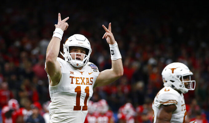 Texas quarterback Sam Ehlinger (11) reacts after a running touchdown during the first half of the Sugar Bowl NCAA college football game against Georgia in New Orleans, Tuesday, Jan. 1, 2019. (AP Photo/Butch Dill)