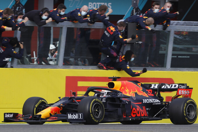 Red Bull driver Max Verstappen of the Netherlands crosses the finish line to win the Emilia Romagna Formula One Grand Prix, at the Imola racetrack, Italy, Sunday, April 18, 2021. (AP Photo/Luca Bruno)
