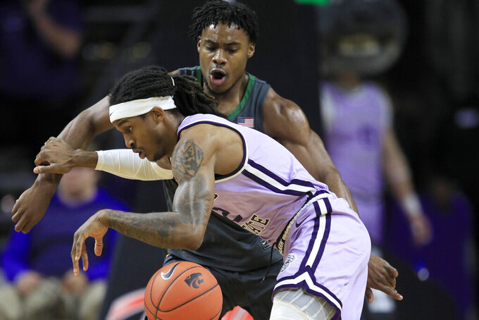 Kansas State guard Cartier Diarra (2) is covered by Baylor guard Davion Mitchell, back, during the first half of an NCAA college basketball game in Manhattan, Kan., Monday, Feb. 3, 2020. (AP Photo/Orlin Wagner)