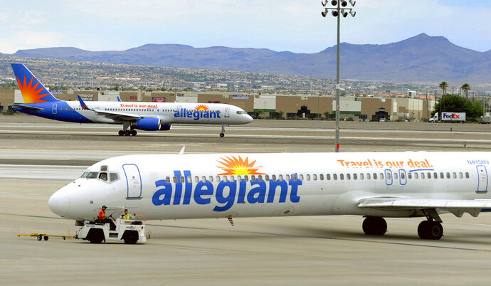 "File - In this May 9, 2013, file photo, two Allegiant Air jets taxi at McCarran International Airport in Las Vegas. Shares of Allegiant Air's parent company are tumbling in Monday, April 16, 2018, premarket trading following a ""60 Minutes"" investigation that expressed serious safety concerns about the airline. (AP Photo/David Becker, File)"