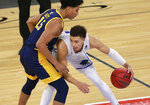 UC Santa Barbara's Jaquori McLaughlin (3) keeps possession of the ball from UC Irvine's Jeron Artest (15) during the second half of an NCAA college basketball game for the championship of the Big West Conference men's tournament Saturday, March 13, 2021, in Las Vegas. (AP Photo/Ronda Churchill)
