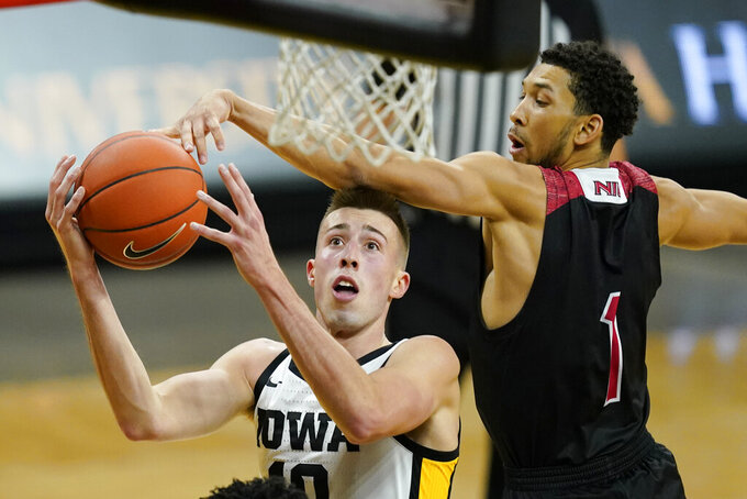 Iowa guard Joe Wieskamp drives to the basket ahead of Northern Illinois guard Trendon Hankerson, right, during the second half of an NCAA college basketball game, Sunday, Dec. 13, 2020, in Iowa City, Iowa. Iowa won 106-54. (AP Photo/Charlie Neibergall)