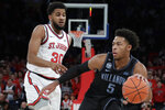 Villanova's Justin Moore (5) drives past St. John's LJ Figueroa (30) during the first half of an NCAA college basketball game Tuesday, Jan. 28, 2020, in New York. (AP Photo/Frank Franklin II)