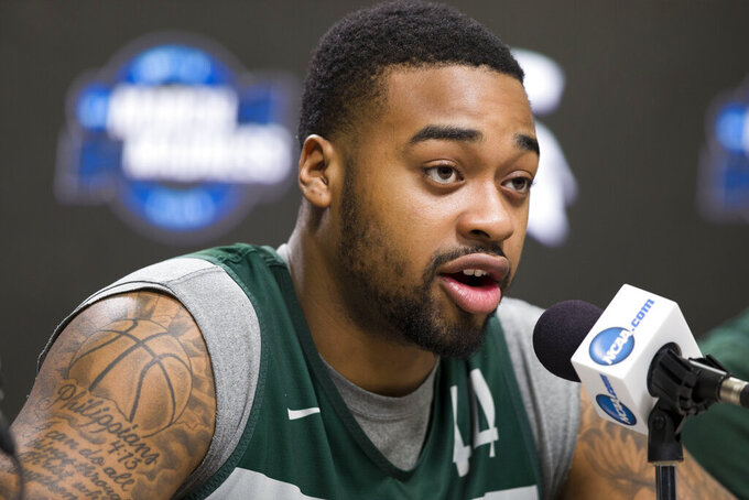 Michigan State forward Nick Ward speaks during an NCAA men's college basketball news conference in Washington, Saturday, March 30, 2019. Michigan State plays Duke in the East Regional final game on Sunday. (AP Photo/Alex Brandon)