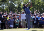 Tiger Woods plays his shot from the eighth tee during the first round of the U.S. Open Golf Championship, Thursday, June 14, 2018, in Southampton, N.Y. (AP Photo/Julio Cortez)