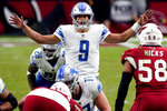 Detroit Lions quarterback Matthew Stafford (9) calls a play during the second half of an NFL football game against the Arizona Cardinals, Sunday, Sept. 27, 2020, in Glendale, Ariz. (AP Photo/Rick Scuteri)