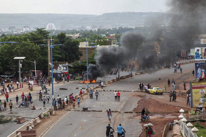 Anti-government protesters burn tires and barricade roads in the capital Bamako, Mali, Friday, July 10, 2020. Thousands marched Friday in Mali's capital in anti-government demonstrations urged by an opposition group that rejects the president's promises of reforms. (AP Photo/Baba Ahmed)