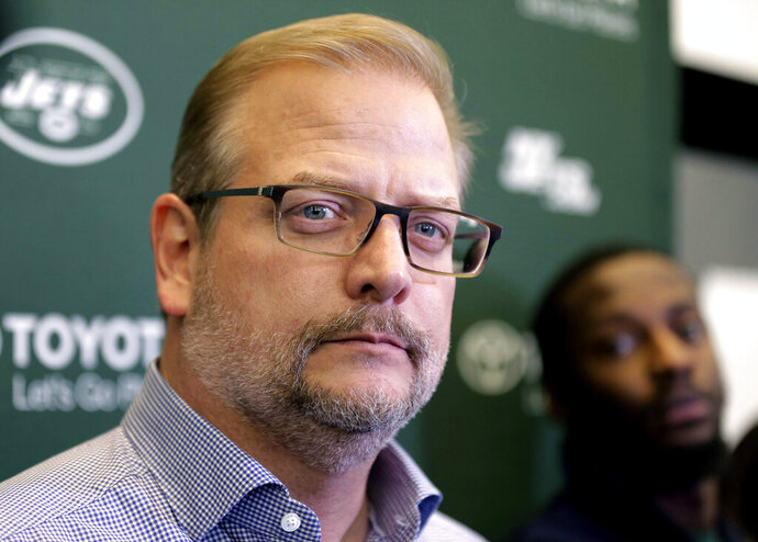 FILE - In this Dec. 31, 2018 file photo, New York Jets general manager Mike Maccagnan speaks to reporters in Florham Park, N.J. The New York Jets have fired Maccagnan and coach Adam Gase will serve as the acting GM in his place. The stunning decision by team chairman and CEO Christopher Johnson was announced in a statement posted on the team's Twitter account. Maccagnan had been the Jets' general manager since 2015. (AP Photo/Seth Wenig, File)