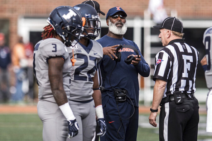 Illinois Head Coach Lovie Smith speaks with an official during a review in the second half of an NCAA college football game against Wisconsin, Saturday, Oct. 19, 2019, in Champaign, Ill. (AP Photo/Holly Hart)
