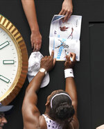 United States' Serena Williams signs autographs after defeating Russia's Anastasia Potapova during their first round singles match at the Australian Open tennis championship in Melbourne, Australia, Monday, Jan. 20, 2020. (AP Photo/Lee Jin-man)