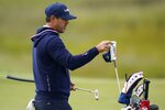 Team USA's Brooks Koepka gets a club on the 10th hole during a practice day at the Ryder Cup at the Whistling Straits Golf Course Wednesday, Sept. 22, 2021, in Sheboygan, Wis. (AP Photo/Ashley Landis)