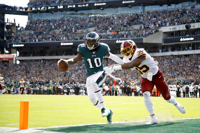 Philadelphia Eagles' DeSean Jackson, left, scores a touchdown against Washington Redskins' Montae Nicholson during the second half of an NFL football game, Sunday, Sept. 8, 2019, in Philadelphia. (AP Photo/Matt Rourke)
