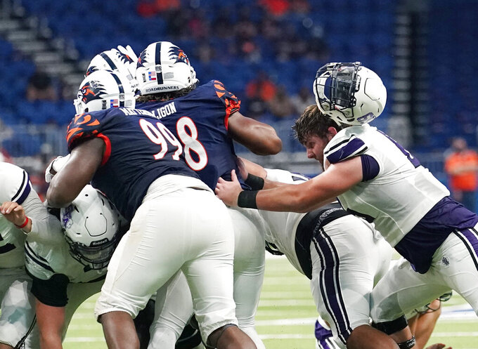 Stephen F. Austin offensive lineman Clint Lapic (65) loses his helmet as he blocks on a play during the second half of an NCAA college football game against UTSA, Saturday, Sept. 19, 2020, in San Antonio. (AP Photo/Eric Gay)
