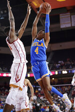 UCLA guard Jaylen Hands, right, goes up for a shot as Southern California forward Victor Uyaelunmo defends during the second half of an NCAA college basketball game Saturday, Jan. 19, 2019, in Los Angeles. USC won 80-67. (AP Photo/Mark J. Terrill)