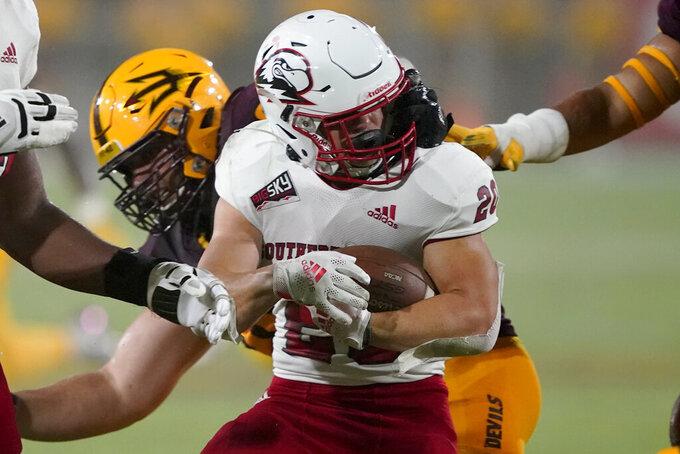 Arizona State defensive lineman D.J. Davidson grabs the face mask of Southern Utah running back Dayne Christiansen (20) during the first half of an NCAA college football game, Thursday, Sept. 2, 2021, in Tempe, Ariz. (AP Photo/Matt York)