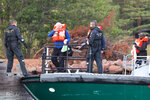 People are evacuated by boat from the Amorella cruise ship near the Aland islands, seen from Finland, Sunday, Sept. 20, 2020. Finnish authorities say a Baltic Sea passenger ferry with nearly 300 people has run aground in the Aland Islands archipelago between Finland and Sweden without injuries. (Niclas Norlund/Lehtikuva via AP)