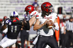 Texas Tech quarterback Henry Colombi (3) looks to throw as TCU defensive end Khari Coleman (11) closes in during the first half of an NCAA college football game Saturday, Nov. 7, 2020, in Fort Worth, Texas. (AP Photo/Ron Jenkins)