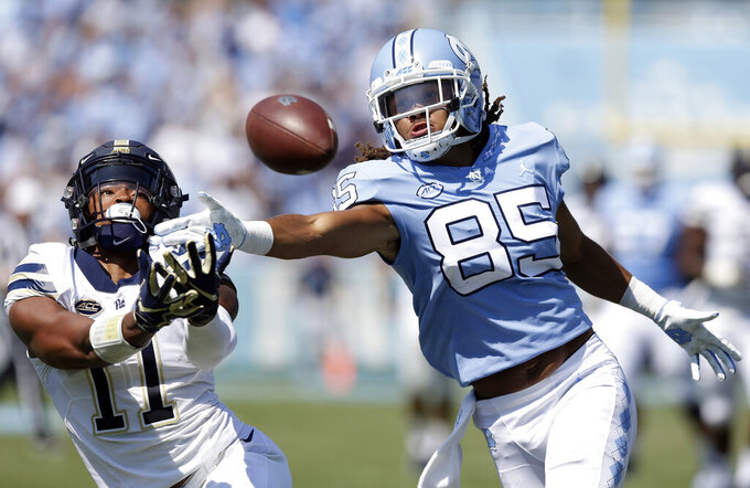 FILE - In a Saturday, Sept. 22, 2018 file photo, Pittsburgh's Dane Jackson (11) and North Carolina's Roscoe Johnson (85) reach for a pass during the first half of an NCAA college football game in Chapel Hill, N.C. Pittsburgh and Eastern Michigan will meet in the Quick Lane Bowl, on Dec. 26, 2019, hoping to end postseason droughts.   (AP Photo/Gerry Broome, File)