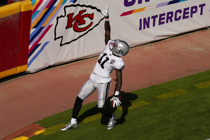 Las Vegas Raiders wide receiver Henry Ruggs III celebrates after catching a 72-yard touchdown pass during the first half of an NFL football game against the Kansas City Chiefs, Sunday, Oct. 11, 2020, in Kansas City. (AP Photo/Charlie Riedel)