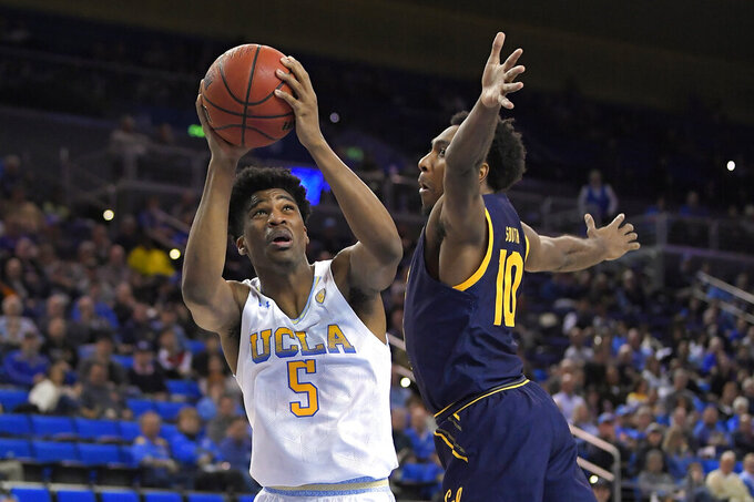 UCLA guard Chris Smith, left, tries to shoot as California guard Kareem South defends during the second half of an NCAA college basketball game Sunday, Jan. 19, 2020, in Los Angeles. UCLA won 50-40. (AP Photo/Mark J. Terrill)