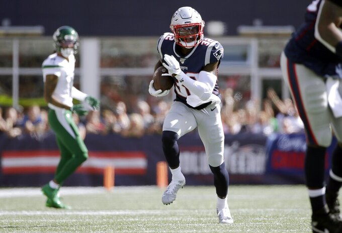 New England Patriots safety Devin McCourty runs with the ball after intercepting a pass against the New York Jets in the second half of an NFL football game, Sunday, Sept. 22, 2019, in Foxborough, Mass. (AP Photo/Elise Amendola)