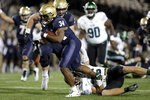 Navy fullback Jamale Carothers (34) avoids a tackle by Tulane safety Chase Kuerschen while scoring a touchdown during the second half of an NCAA college football game, Saturday, Oct. 26, 2019, in Annapolis. Navy won 41-38. (AP Photo/Julio Cortez)