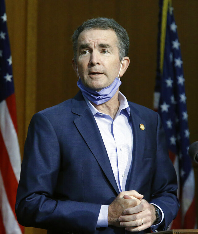 Virginia Governor Ralph Northam answers a question during a press briefing inside the Patrick Henry Building in Richmond, Va., Tuesday, June 23, 2020. (Bob Brown/Richmond Times-Dispatch via AP)
