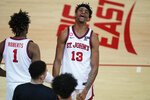 St. John's Isaih Moore (13) celebrates with Josh Roberts (1) after an NCAA college basketball game against Villanova on Wednesday, Feb. 3, 2021, in New York. (AP Photo/Frank Franklin II)