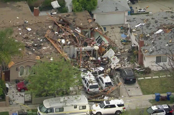 This image from video provided by KTLA5, shows the aftermath of an explosion at a home in Los Angeles on Monday, April 12, 2021. The explosion shattered the home in a San Fernando Valley neighborhood and leveled its garage, trapping one man in the debris and sending another to the hospital with critical burn injuries, authorities said Monday. (KTLA5 via AP)