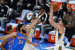 Indiana Pacers forward Doug McDermott, right, shoots over Oklahoma City Thunder forward Kenrich Williams, left, in the first half of an NBA basketball game Saturday, May 1, 2021, in Oklahoma City. (AP Photo/Sue Ogrocki)