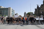 Protesters prepare to march in the streets Monday, June 1, 2020, in St. Louis. Protesters gathered to speak out against the death of George Floyd who died after being restrained by Minneapolis police officers on May 25. (AP Photo/Jeff Roberson)