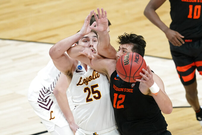 Oregon State center Roman Silva (12) drives past Loyola Chicago center Cameron Krutwig (25) during the first half of a Sweet 16 game in the NCAA men's college basketball tournament at Bankers Life Fieldhouse, Saturday, March 27, 2021, in Indianapolis. (AP Photo/Darron Cummings)