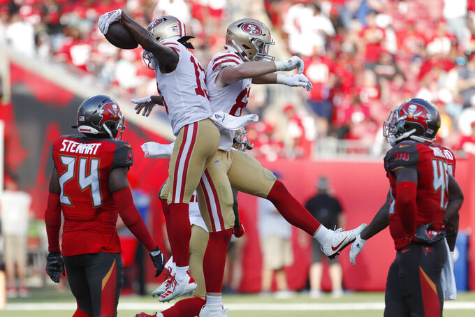 San Francisco 49ers wide receiver Richie James (13) celebrates his touchdown against the Tampa Bay Buccaneers during the second half an NFL football game, Sunday, Sept. 8, 2019, in Tampa, Fla. (AP Photo/Mark LoMoglio)