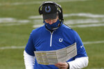 Indianapolis Colts head coach Frank Reich checks his play card as his team plays against the Pittsburgh Steelers during the second half of an NFL football game, Sunday, Dec. 27, 2020, in Pittsburgh. (AP Photo/Don Wright)
