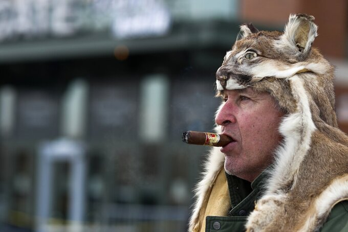 Al Polinksi makes his way to Lambeau Field before an NFL football game between the Green Bay Packers and the Washington Redskins Sunday, Dec. 8, 2019, in Green Bay, Wis. (AP Photo/Matt Ludtke)