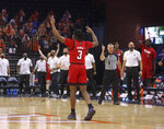 North Carolina State guard Cam Hayes (3) celebrates a 3-point basket against Virginia during an NCAA college basketball game Wednesday, Feb. 24, 2021, in Charlottesville, Va. (Andrew Shurtleff/The Daily Progress via AP, Pool)