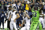Los Angeles Rams' Greg Zuerlein (4) and Seattle Seahawks free safety Tedric Thompson (33) react after Zuerlein missed a field goal in the final seconds of an NFL football game Thursday, Oct. 3, 2019, in Seattle. The Seahawks won 30-29. (AP Photo/Elaine Thompson)