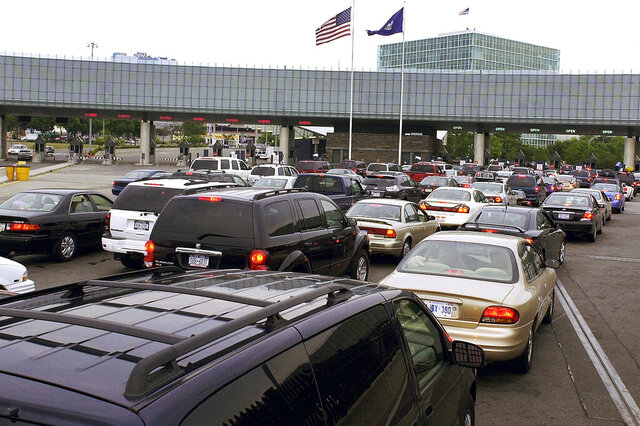 FILE - In this Aug. 4, 2005, file photo, traffic traveling from Niagara Falls, Ontario, Canada, lines up on the Rainbow Bridge to enter the United States through a border checkpoint at Niagara Falls, N.Y. The Department of Homeland Security said on Thursday, June 23, 2020, that New Yorkers would once again be allowed to enroll and re-enroll in Global Entry and other federal travel programs that allow vetted travelers to avoid long security lines at the U.S. border. (AP Photo/Don Heupel, File)