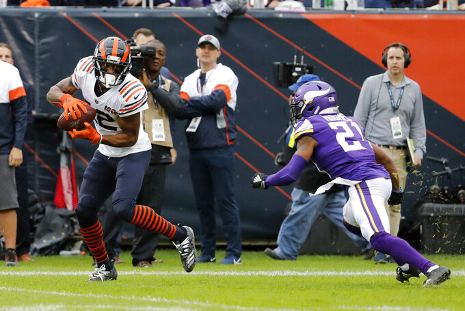 Chicago Bears wide receiver Allen Robinson, left, catches a pass as Minnesota Vikings cornerback Mike Hughes defends during the half of an NFL football game Sunday, Sept. 29, 2019, in Chicago. (AP Photo/Jeff Roberson)