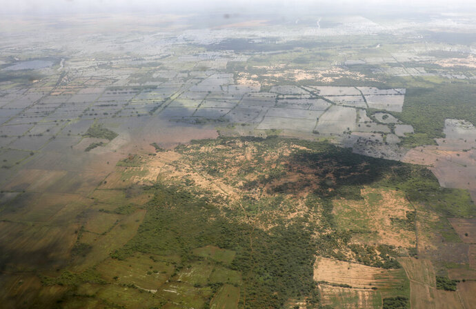 This photo taken Tuesday, Nov. 12, 2019, shows an aerial view of the flooded Hiran region of central Somalia. Authorities have not yet said how many people died in Somalia's recent flooding, the country's worst in recent history and the latest reminder that the Horn of Africa nation must prepare for the extremes predicted to come with a changing climate. (AP Photo/Mohamed Sheikh Nor)