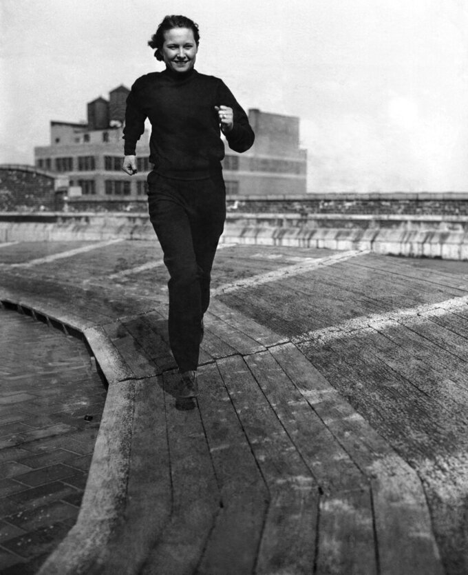 FILE - In this April 13, 1934, file photo, Betty Robinson of Chicago, who won the 100-meter sprints in the 1928 Olympics, is seen working out on a roof track in New York. (AP Photo/File)