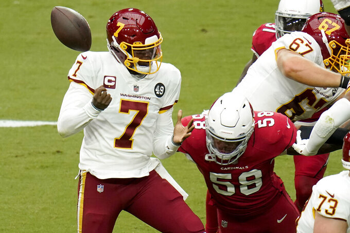 Washington Football Team quarterback Dwayne Haskins (7) fumbles the ball after being hit by Arizona Cardinals middle linebacker Jordan Hicks (58) during the first half of an NFL football game, Sunday, Sept. 20, 2020, in Glendale, Ariz. The Cardinals recovered the ball. (AP Photo/Ross D. Franklin)